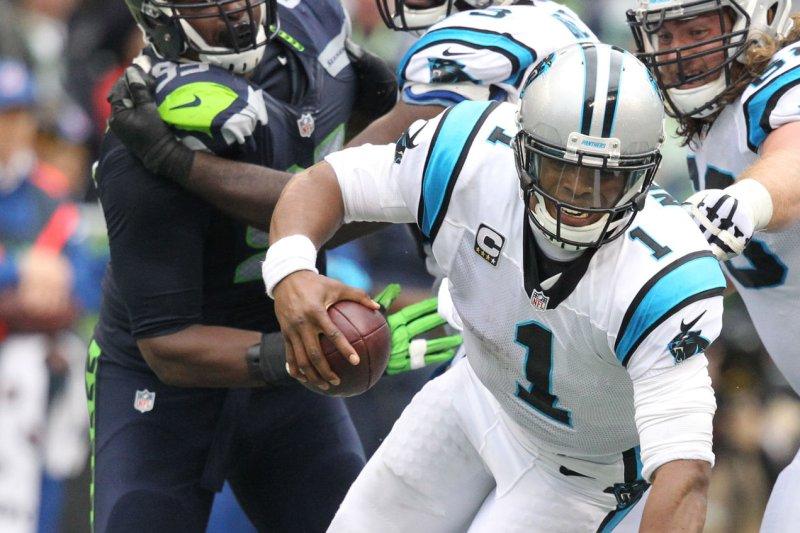 Seattle Seahawks linebacker Bruce Irvin (51) sacks Carolina Panthers quarterback Cam Newton (1). Photo by Jim Bryant/UPI