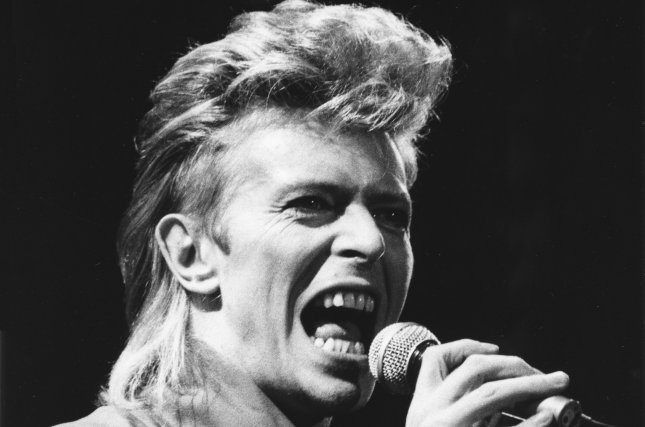 """Veteran British rocker David Bowie opens the first of two concerts at Giants Stadium late August 2, 1987, during his """"Glass Spider"""" tour in East Rutherford, N.J. Bowie died Sunday of cancer. File photo by Roth/UPI"""