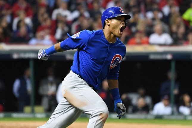 Chicago Cubs shortstop Addison Russell reacts after hitting a grand slam home run against the Cleveland Indians during the third inning in game 6 of the World Series at Progressive Field in Cleveland, Ohio on November 1, 2016. Russell had 6 RBI's to lead the Cubs' effort. Photo by Pat Benic/UPI