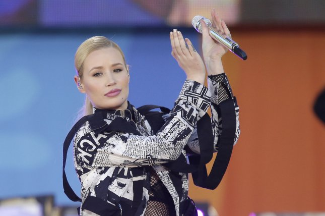 Iggy Azalea performs on Good Morning America at the Rumsey Playfield/SummerStage in Central Park in New York City on June 10. Azalea opened up about her plastic surgery on social media by wishing her plastic surgeon a happy birthday. File Photo by John Angelillo/UPI