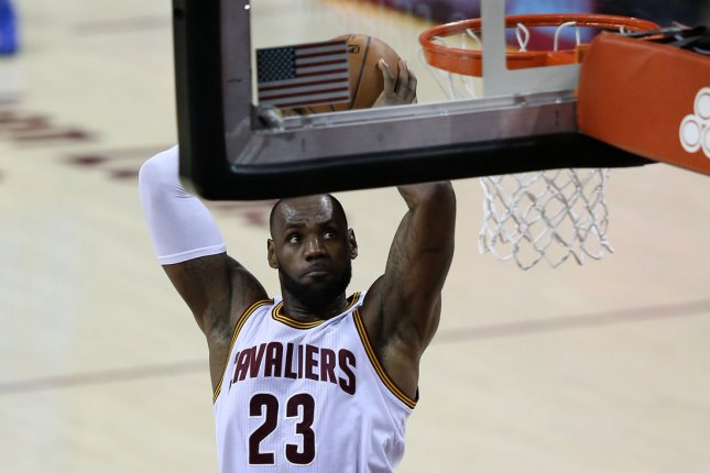 Cleveland Cavaliers' LeBron James dunks during the second half. File photo by Aaron Josefczyk/UPI