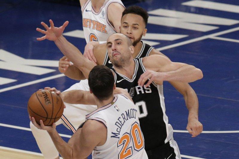 San Antonio Spurs' Manu Ginobili defends New York Knicks' Doug McDermott who looks to pass the basketball Tuesday at Madison Square Garden in New York City. Photo by John Angelillo/UPI