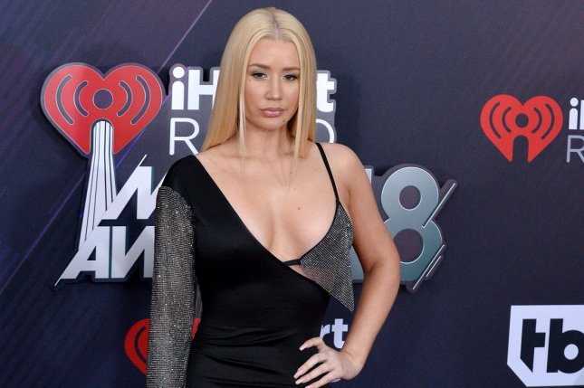 Iggy Azalea is seen floating in a pool of money in a new image released on Twitter. File Photo by Jim Ruymen/UPI