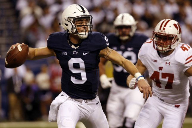 Penn State Nittany Lions quarterback Trace McSorley (9) throws under pressure from Wisconsin Badgers defender Vince Bigel (47) during the first half of play in 2016 Big Ten Football Championship Game on December 3, 2016 in Indianapolis. File photo by John Sommers II/UPI