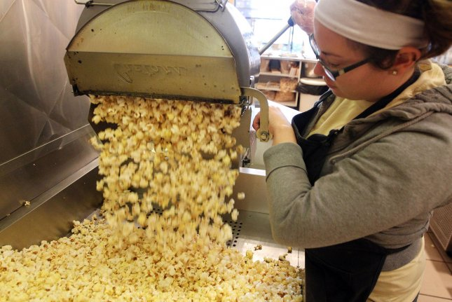 Bridgett O'Brian makes a fresh batch of popcorn in 2014. Popcorn prices are predicted to increase, as supplies dwindle from farmers unable to plant this spring. File Photo by Bill Greenblatt/UPI