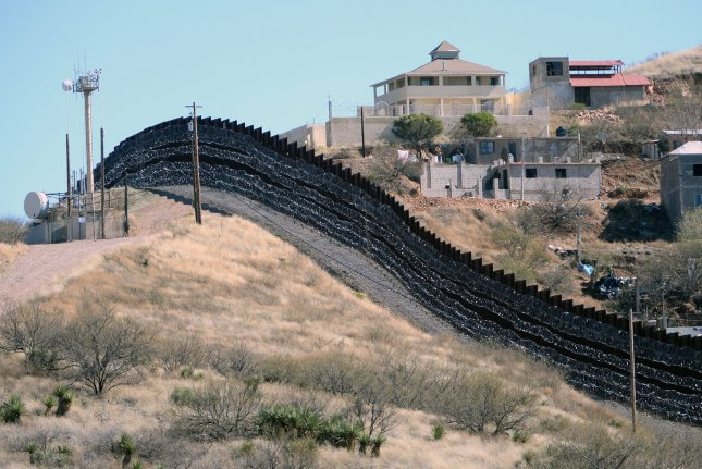 A section of border wall is seen in Nogales, Ariz. A judge's ruling Thursday said President Donald Trump lawfully used an emergency declaration last year that allowed him to divert funds to the border wall. File Photo by Art Foxall/UPI