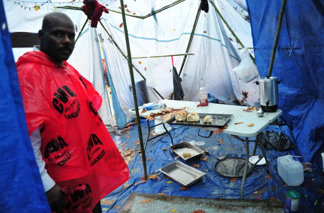 An Occupy DC member shows off dirty living conditions inside a tent at the McPherson Square Occupy camp in downtown Washington, DC on December 7, 2011. UPI/Kevin Dietsch