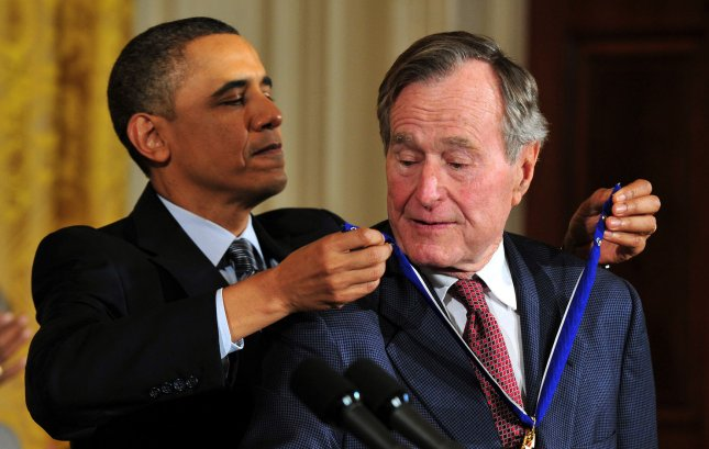 President Barack Obama awards the 2010 Presidential Medal of Freedom to President George H. W. Bush during a ceremony at the White House in Washington on February 15, 2011. UPI/Kevin Dietsch