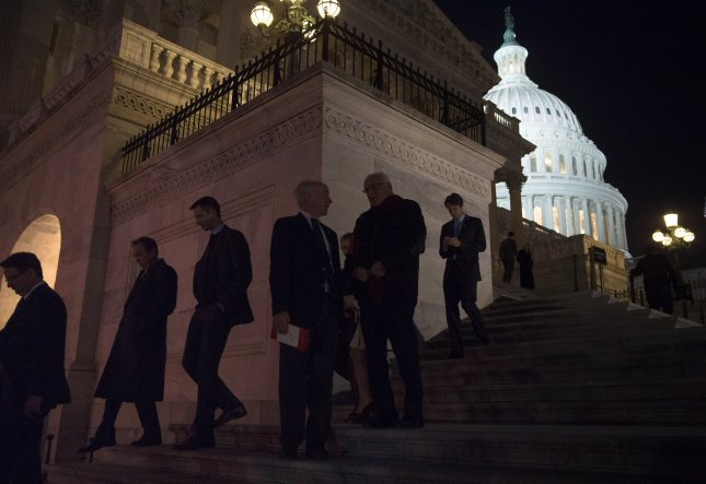 Members of Congress leave the House of Representatives after voting on the House budget bill before recessing for the year, on Capitol Hill in Washington, D.C. on December 12, 2013. UPI/Kevin Dietsch