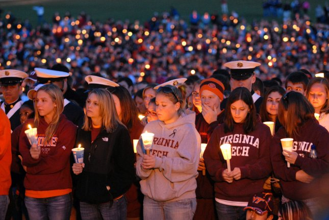 Virginia Tech students, faculty, staff and community members participate in a candle light vigil in memory of the 32 students and staff who died two shooting incidents on campus on April 17, 2007. A judge recently said that the Virginia Attorney General can defend Virginia Tech against two wrongful-death lawsuits relating to the shootings. (UPI Photo/Roger L. Wollenberg)