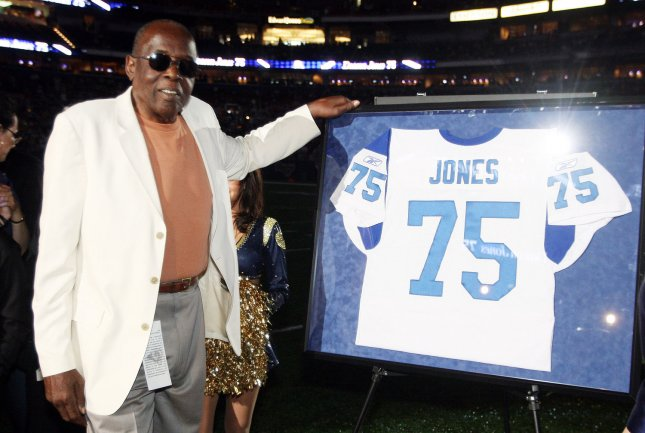 Hall of Fame defensive end David DeaconJones who played for the Los Angeles Rams between 1961-1971 stands next to his number 75, as the Rams retire the number before the Green Bay Packers-St. Louis Rams football game at the Edward Jones Dome in St. Louis on September 27, 2009. UPI/Bill Greenblatt
