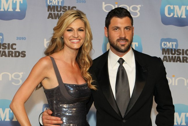 Erin Andrews (L) and Maksim Chmerkovskiy speak to the press at the Country Music Television Awards in Nashville, Tennessee on June 9, 2010. UPI/Terry Wyatt