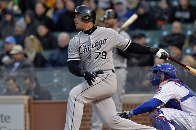 Chicago White Sox first baseman Jose Abreu follows through on a sacrifice fly scoring Alejandro De Aza during the first inning against the Chicago Cubs at Wrigley Field on May 5, 2014 in Chicago. UPI/Brian Kersey