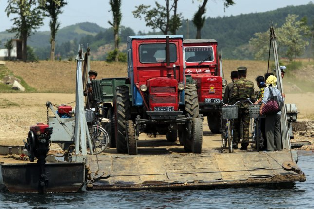 North Koreans wait to cross part of the Yalu River at a makeshift pontoon dock near Sinuiju, across the Yalu River from Dandong, China's largest border city with North Korea, in Liaoning Province, on May 28, 2015. China remains North Korea's most important ally and North Korea's No. 1 trading partner. Photo by Stephen Shaver/UPI