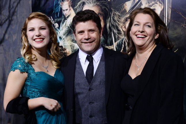 Sean Astin (C), pictured with daughter Ali (L) and wife Christine Astin, responded to reports of a possible Lord of the Rings series at Amazon. File Photo by Jim Ruymen/UPI