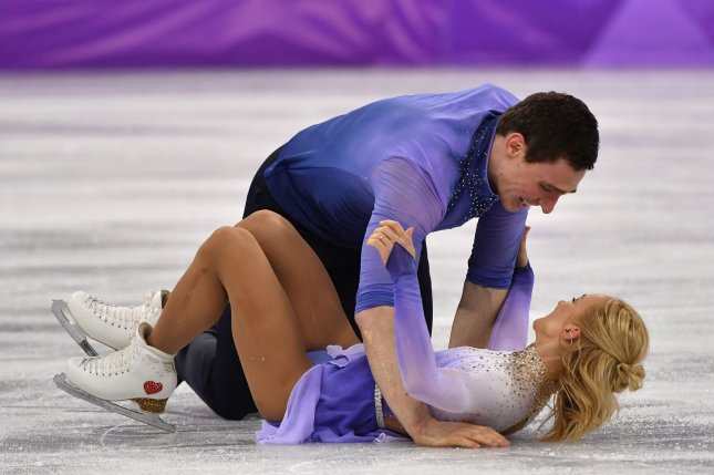 Aljona Savchenko and Bruno Massot of Germany collapse to the ice after a nearly flawless performance in the Pairs Figure Skating Free Skating Program during the Pyeongchang 2018 Winter Olympics Thursday at the Gangneung Ice Arena in Gangneung, South Korea. Photo by Richard Ellis/UPI