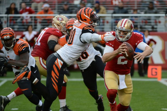 Cincinnati Bengals defensive end Michael Johnson (90) gets a hand on former San Francisco 49ers quarterback Blaine Gabbert in the second quarter on December 20, 2015 at Levi's Stadium in Santa Clara, California. File photo by Terry Schmitt/UPI