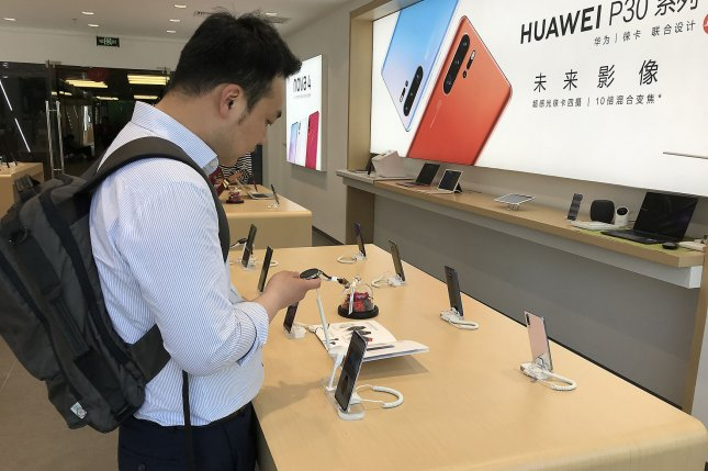 Chinese customers shop at a Huawei store in Beijing, China, on May 20. Photo by Stephen Shaver/UPI