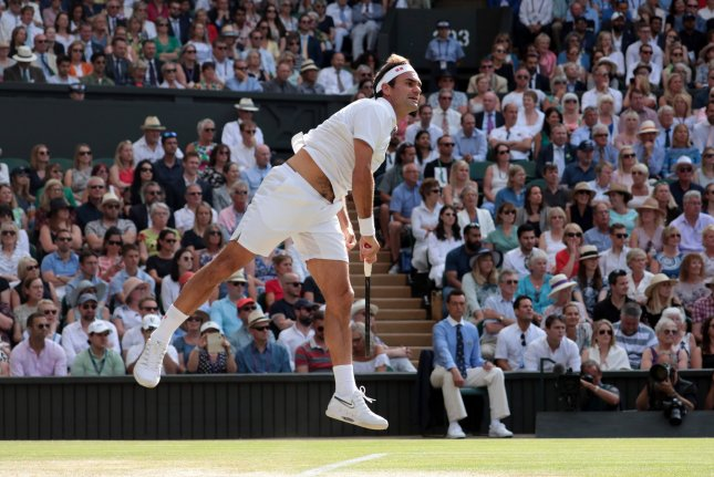 Swiss Roger Federer returns the ball in his Semi-Final match with Spain's Rafael Nadal at Wimbledon on Friday. Photo by Hugo Philpott/UPI