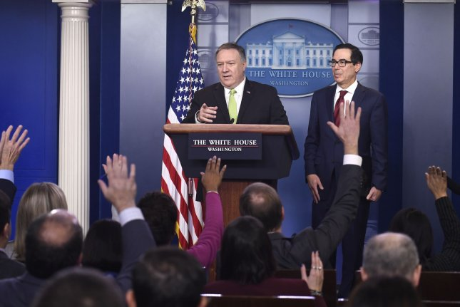 U.S. Secretary of State Mike Pompeo (L) calls on a reporter Friday during a news conference with Treasury Secretary Steven Mnuchin, at which they announced new sanctions against Iran. Photo by Mike Theiler/UPI
