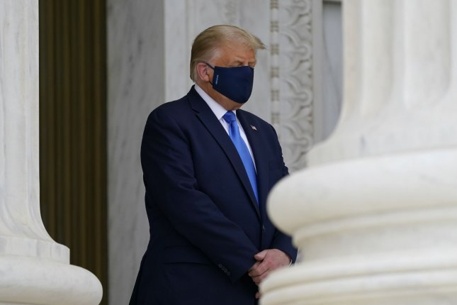 President Donald Trump pays respects as Supreme Court Justice Ruth Bader Ginsburg lies in repose at the top of the front steps of the U.S. Supreme Court building on Thursday. Trump plans to nominate Amy Coney Barrett to succeed Ginsburg on the high court. Pool Photo by Alex Brandon/UPI