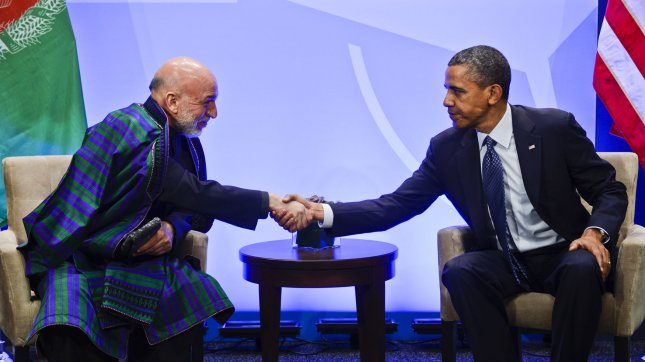 Afghanistan President Hamid Karzai (L) talks with President Barack Obama before the start of the 2012 NATO Summit on May 20, 2012 in Chicago. UPI/Shawn Thew/Pool