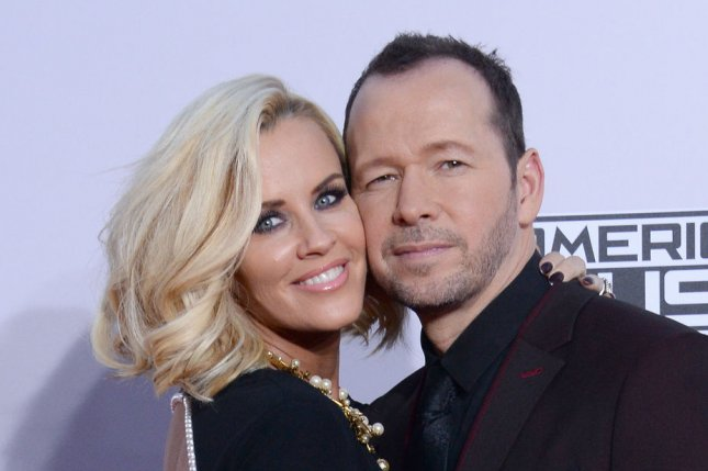 Jenny McCarthy (L) with husband Donnie Wahlberg. File photo by Jim Ruymen/UPI
