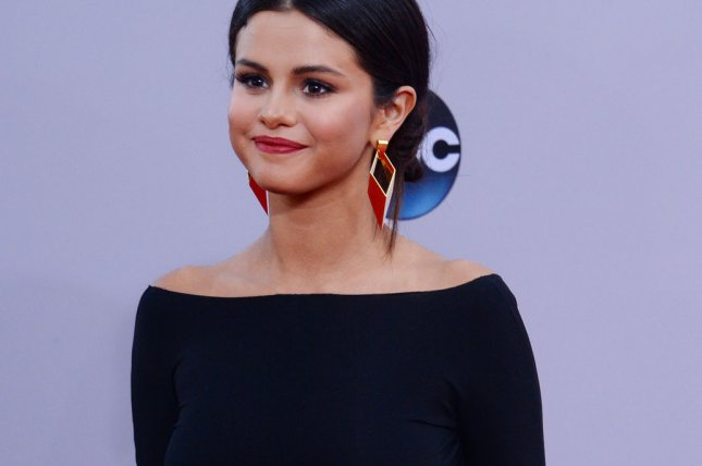 Singer and actress Selena Gomez arrives for the 42nd annual American Music Awards held at Nokia Theatre L.A. Live in Los Angeles on November 23, 2014. Her video for 'Good For You' features a steamy shower scene. Photo by Jim Ruymen/UPI