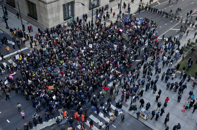 Demonstrators gather Wednesday outside Chicago City Hall as Mayor Rahm Emanuel addresses the City Council about the recent troubles in the Police Department. Photo by Kamil Krzaczynski/UPI