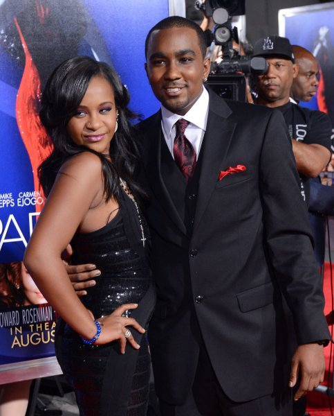 Bobbi Kristina Brown and her boyfriend Nick Gordon attend the premiere of the motion picture drama Sparkle in 2012. She was found unresponsive in her bathtub and died in a hospice in July. Her father, Bobby Brown, will appear on 20/20 Tuesday where he will talk about how he and Whitney Houston could have done better with their daughter. FIle photo by Jim Ruymen/UPI