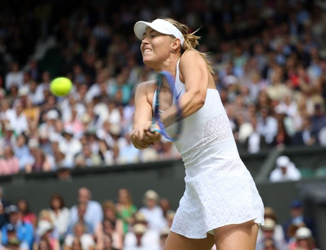 Russian tennis star Maria Sharapova, shown here playing in the 2015 Wimbledon championships, tested positive this year for meldonium, a drug that increases blood flow so more oxygen can be carried to muscle tissue. The World Anti-Doping Agency wants all Russian athletes to be banned from the Olympics this year in Rio. File Photo by Hugo Philpott/UPI