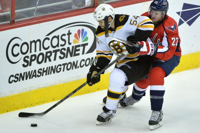 Boston Bruins defenseman Adam McQuaid expects to be in the lineup on Monday, two days removed from receiving 25 stitches to close a wound in his neck after being cut by the skate of teammate David Backes. File Photo by Kevin Dietsch/UPI