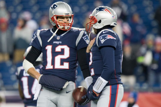 910ff51c1 New England Patriots quarterback Tom Brady (12) chats with quarterback  Brian Hoyer (2) prior to the AFC Divisional round playoff game against the  Tennessee ...