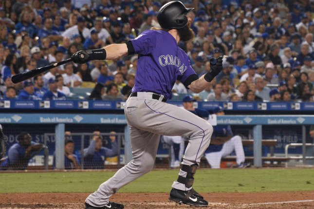 Colorado Rockies center fielder Charlie Blackmon watches his solo home run in the fifth inning off Los Angeles Dodgers starting pitcher Clayton Kershaw go 447 feet into the pavilion in right-center field on Tuesday at Dodger Stadium in Los Angeles. Photo by Jim Ruymen/UPI