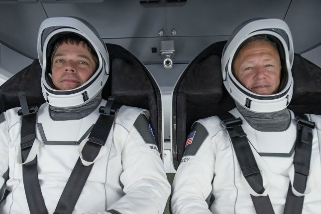 NASA astronauts Bob Behnken (L) and Doug Hurley have a full schedule for their historic first mission aboard a SpaceX Crew Dragon capsule and on the International Space Station. File Photo courtesy of SpaceX/NASA
