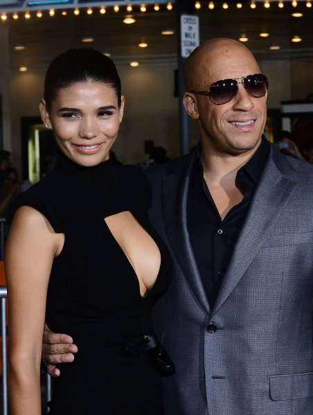 Lead actor Vin Diesel and his long time girlfriend Paloma Jimenez, Mexican model, attend the premiere of the sci-fi motion picture thriller Riddick at the Regency Village Theatre in the Westwood section of in Los Angeles on August 28, 2013. Left for dead on a sun-scorched planet, Riddick fights for survival against alien predators. Riddick seeking to escape the planet activates an emergency beacon alerting two ships: one carrying a new breed of mercenary, the other captained by a man from Riddick's past. UPI/Jim Ruymen