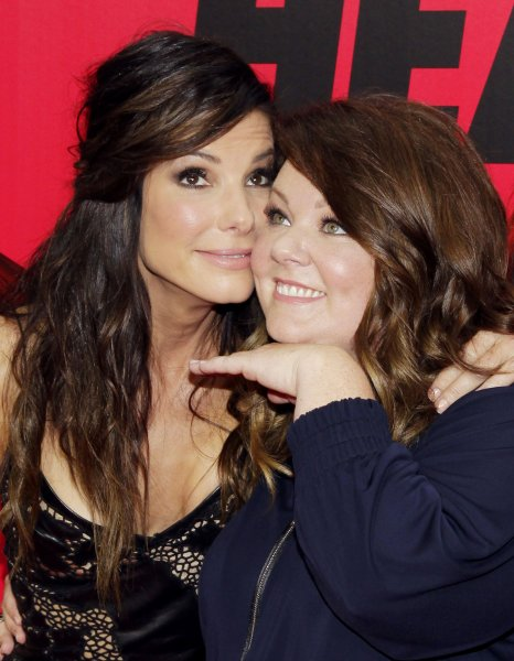 Sandra Bullock and Melissa McCarthy arrive on the red carpet at the New York Premiere of 'The Heat' at the Ziegfeld Theatre in New York City on June 23, 2013. UPI/John Angelillo