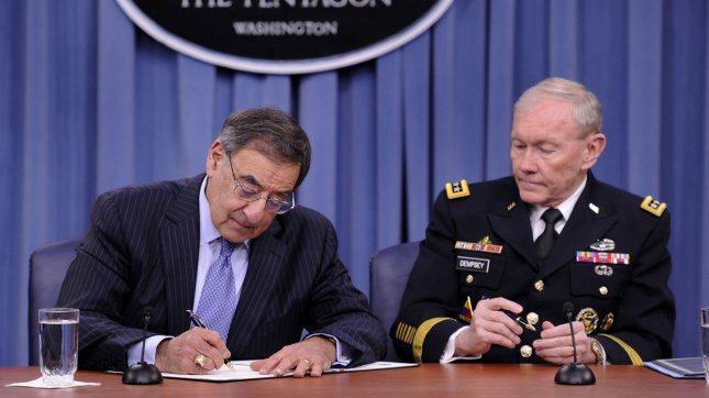 Out-going Defense Secretary Leon Panetta (L) signs the memorandum lifting the ban on women in combat as Chairman of the Joint Chiefs of Staff Gen. Martin Dempsey waits his turn, at the Pentagon, in Arlington, Virginia, January 24, 2013. The ruling formalizes a fact that women have been serving and dying on the front lines in Afghanistan and Iraq for over ten years. UPI/Mike Theiler
