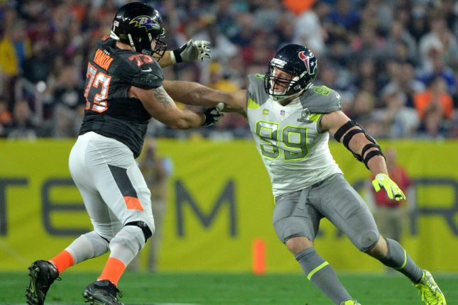 Houston Texans DE J.J. Watt rushes against Baltimore Ravens G Marshal Yanda during the 2015 Pro Bowl at University of Phoenix Stadium in Glendale, Ariz. File photo byKevin Dietsch/UPI