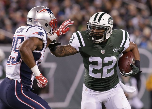 Recently retired New York Jets running back Matt Forte looks for running room during a game against the New England Patriots in 2016. Photo by John Angelillo/UPI