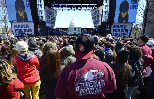Two employees at the Marjory Stoneman Douglas High School were fired after they saw the alleged shooter come on the campus but did not do anything to prevent a massacre that killed 17 people. File Photo by David Tulis /UPI