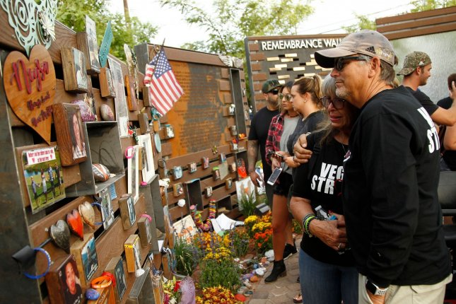 Chris and Debbie Davis, parents of Neysa Tonks, who was killed during the 2017 Las Vegas mass shooting, view a display dedicated to their late daughter at the Healing Gardens memorial on the one-year anniversary of the attack, in Las Vegas, Nevada on Oct 1, 2018. The Justice Department announced Tuesday it would ban bump stocks, the device used in the 2017 shooting that killed dozens. File Photo by James Atoa/UPI