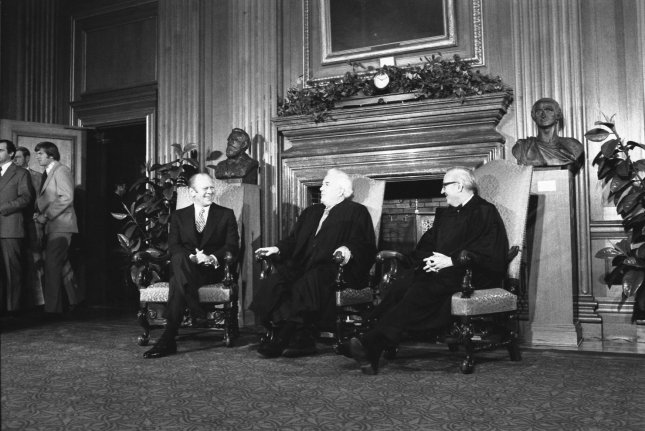 Supreme Court Justice John Paul Stevens (R), with President Gerald Ford and Justice Warren Burger in 1975. File Photo by David Hume Kennerly/William Fitz-Patrick/Gerald R. Ford Library