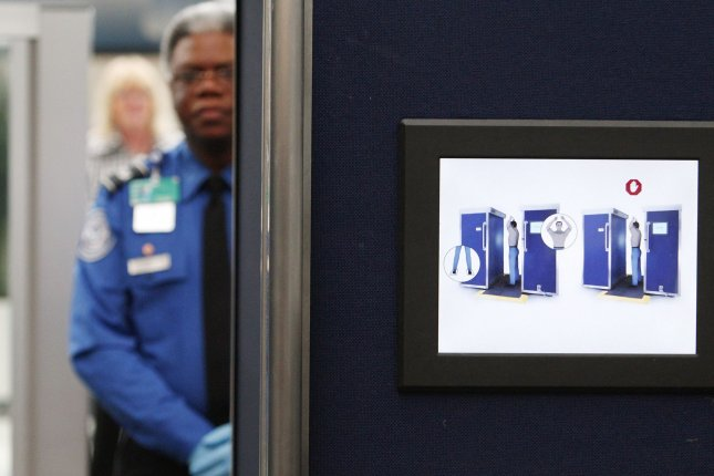 A screener stands at a security checkpoint at O'Hare International Airport in Chicago, Ill. The TSA said Monday screeners confiscated three firearms from carry-on bags at the airport last month. File Photo by Brian Kersey/UPI