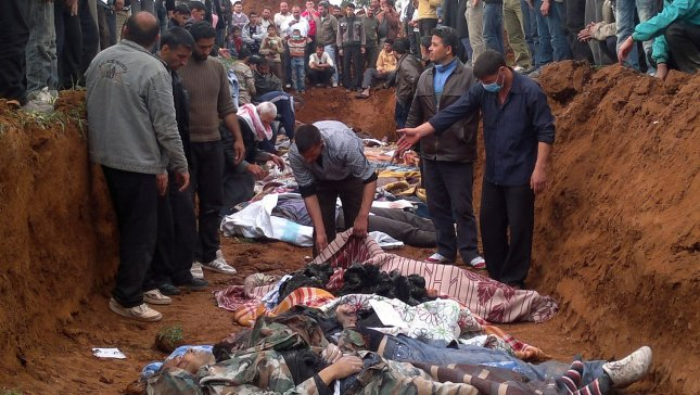 People bury the bodies of men activists say were killed by the Syrian government army, in Taftanaz village, east of Idlib, Syria April 5, 2012. Syrian government shelling and offensives against rebel-held towns killed dozens of civilians across the country on activists said. Syrian President Bashar Assad has accepted a cease-fire deadline brokered by international envoy Kofi Annan, which calls for his forces to pull out of towns and cities by Tuesday and for both government and rebels to lay down their arms by 6 a.m. local time Thursday. UPI