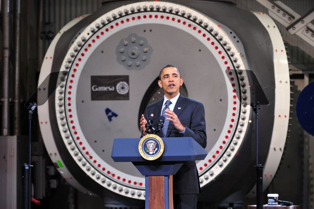 President Barack Obama speaks in front of a wind turbine hub as he holds an energy town hall discussion. UPI/Kevin Dietsch