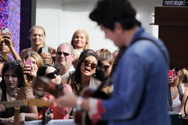 Fans watch John Mayer as he performs on the NBC Today Show at Rockefeller Center in New York City on July 5, 2013. UPI/John Angelillo