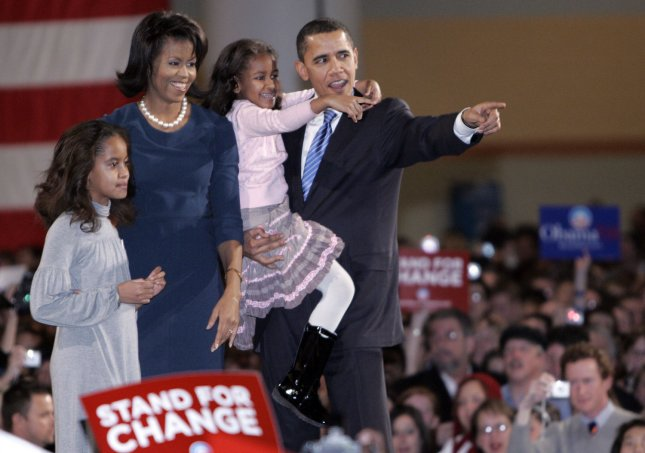 Democratic presidential hopeful Sen. Barack Obama (D-IL) and his wife Michelle, and children Malia (L) and Sasha greet supporters at a victory rally in Des Moines, Iowa on January 3, 2008. Obama emerged with a clear win over rivals John Edwards and Hillary Clinton in the Democratic caucus. (UPI Photo/Mark Cowan)