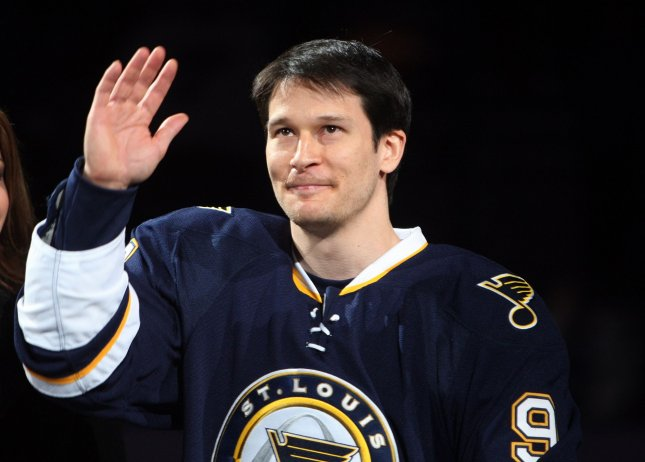 Paul Kariya, then with the St. Louis Blues, waves to the crowd during a ceremony before a game against the Dallas Stars at the Scottrade Center in St. Louis, April 3, 2010, honoring him for scoring his 400th career goal. UPI/Bill Greenblatt