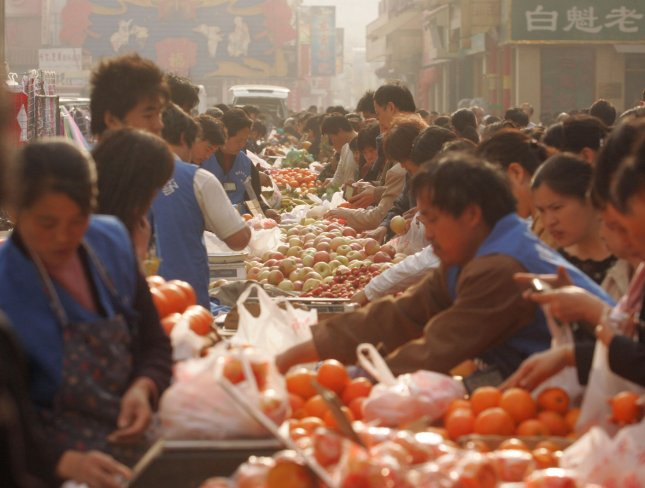Chinese shoppers buy all sorts of fruits at a massive, morning food market in Beijing on April 20, 2008. The cost of food has increased by around 40 percent since mid-2007 worldwide, and the strain has caused riots and protests in countries like China, Thailand, Cameroon, Burkina Faso, Haiti and Egypt. (UPI Photo/Stephen Shaver)